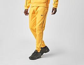 yellow-nike-nocta-fleece-pant